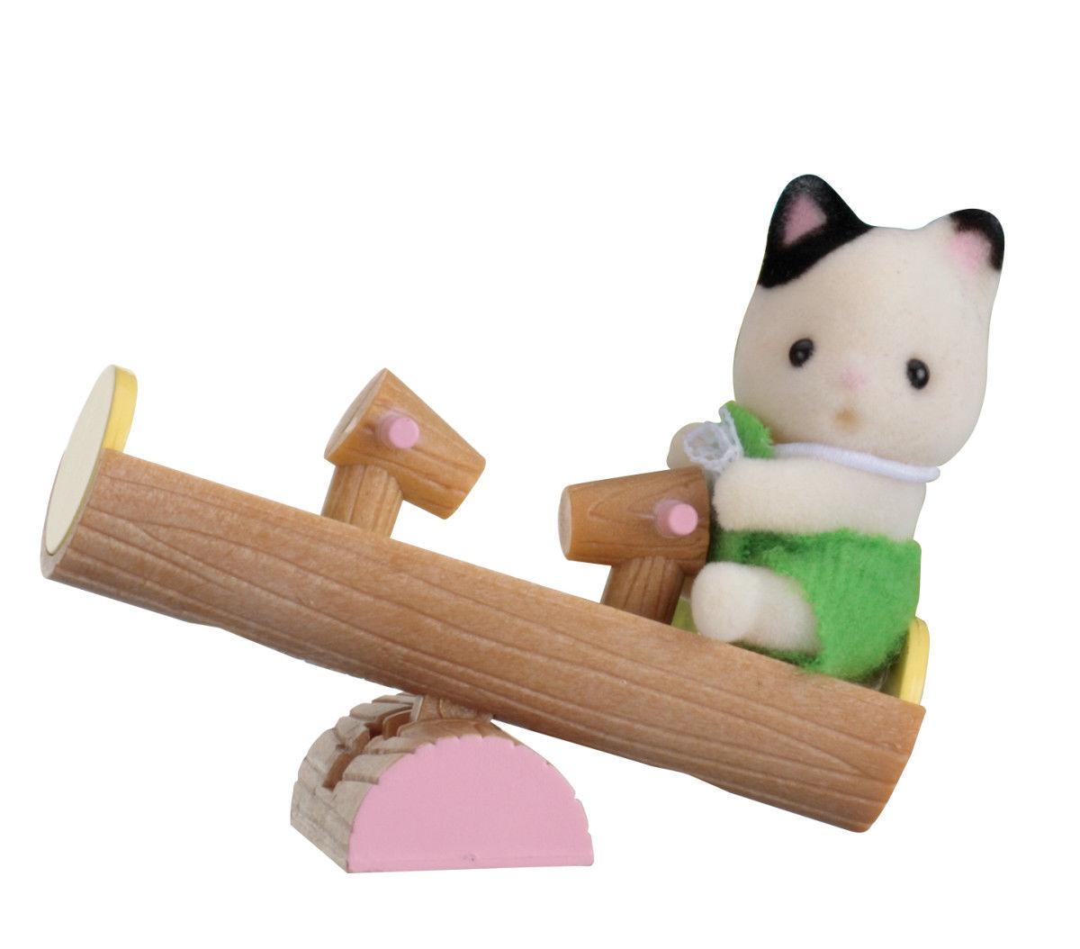 משפ' סילבניאן - תינוק בתיק חתול על נדנדה משפחת סילבניאן